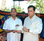 Chief Minister handed over a cheque of Rs 20 lakh to the father of slain martyr as ex-gratia.