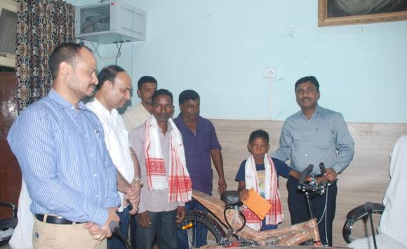 Sonitpur district administration felicitated 11-year-old Uttam Tanti, who saved two persons from drowning in rising floodwaters